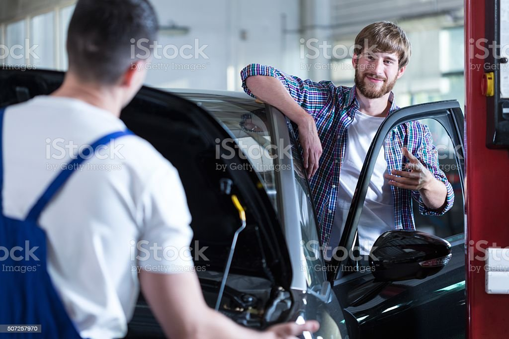 Content customer of service station stock photo