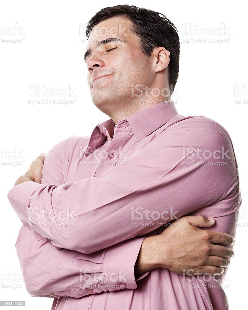 Content Man Hugs Himself stock photo