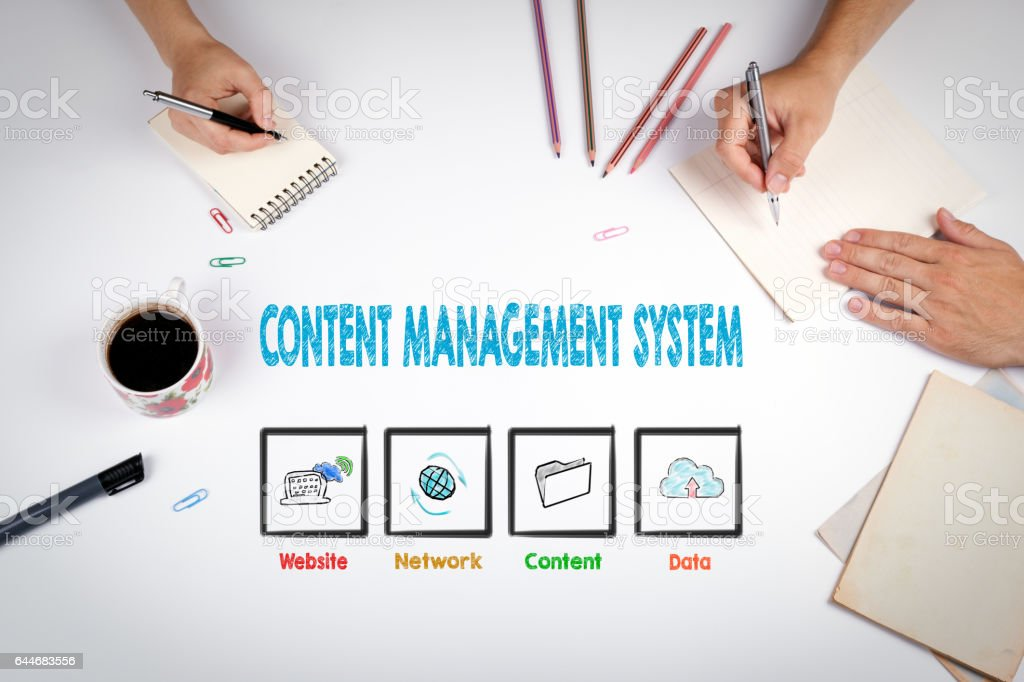 Content Management System concept. The meeting at the white office table stock photo