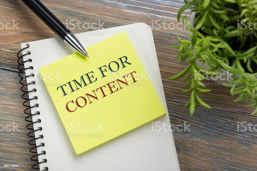 Content, online concept. Notepad with message, pen and flower. Office stock photo