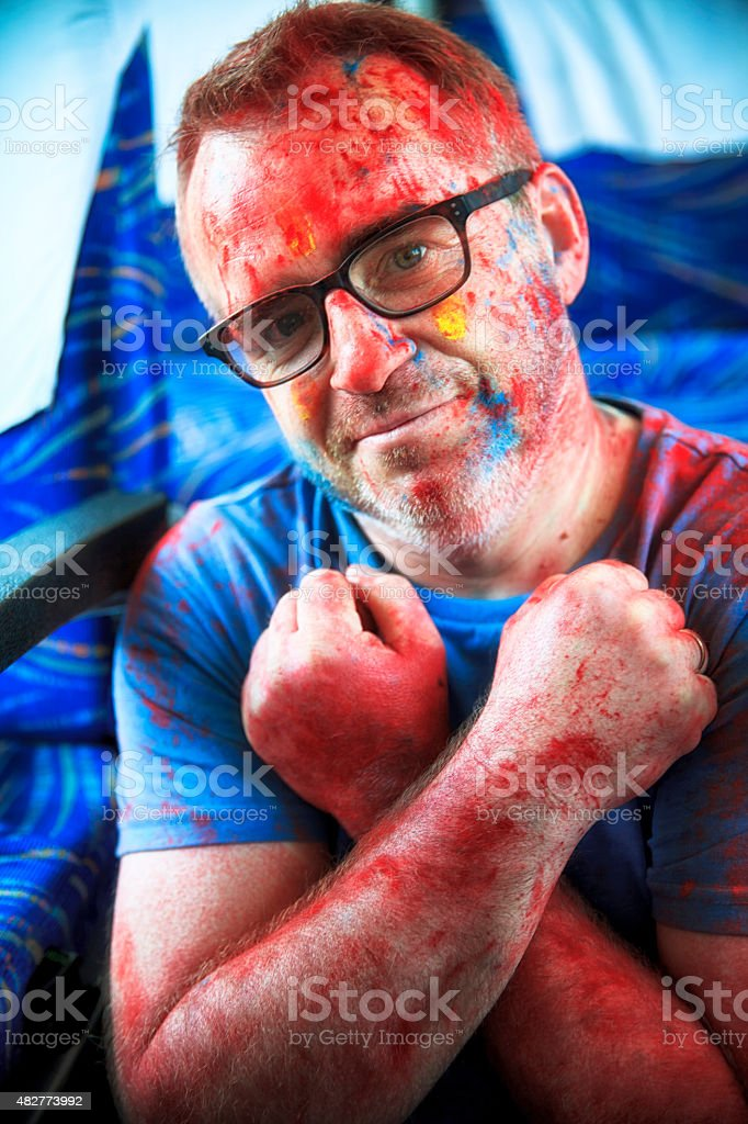 Content photographer after Holi Festival stock photo