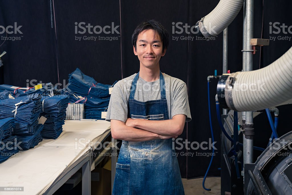 content textile industry worker washing and sorting garments before shipping stock photo