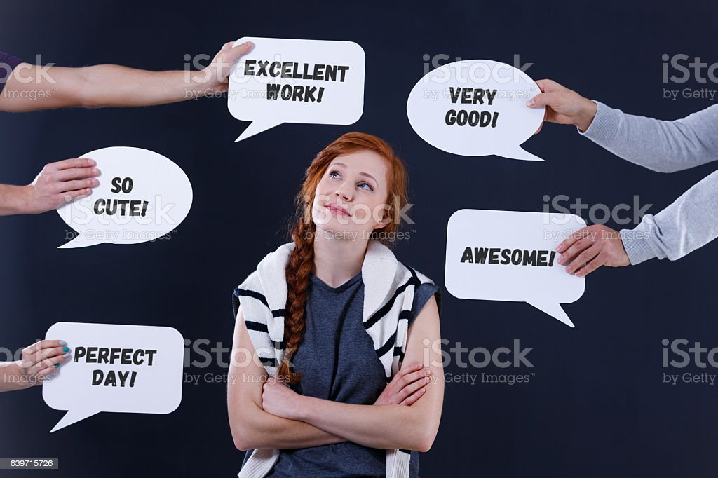 Content woman and speech bubbles stock photo