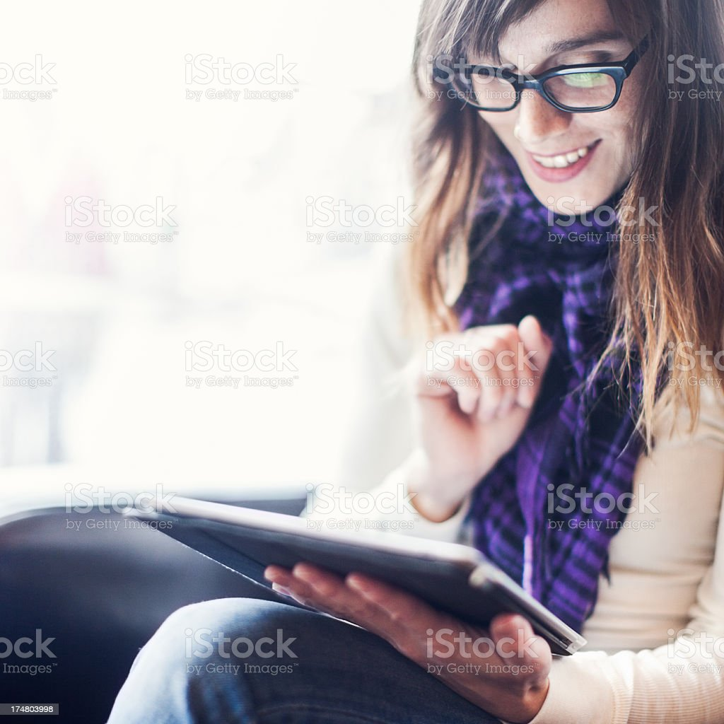 Content Woman with Digital Tablet and Coffee stock photo