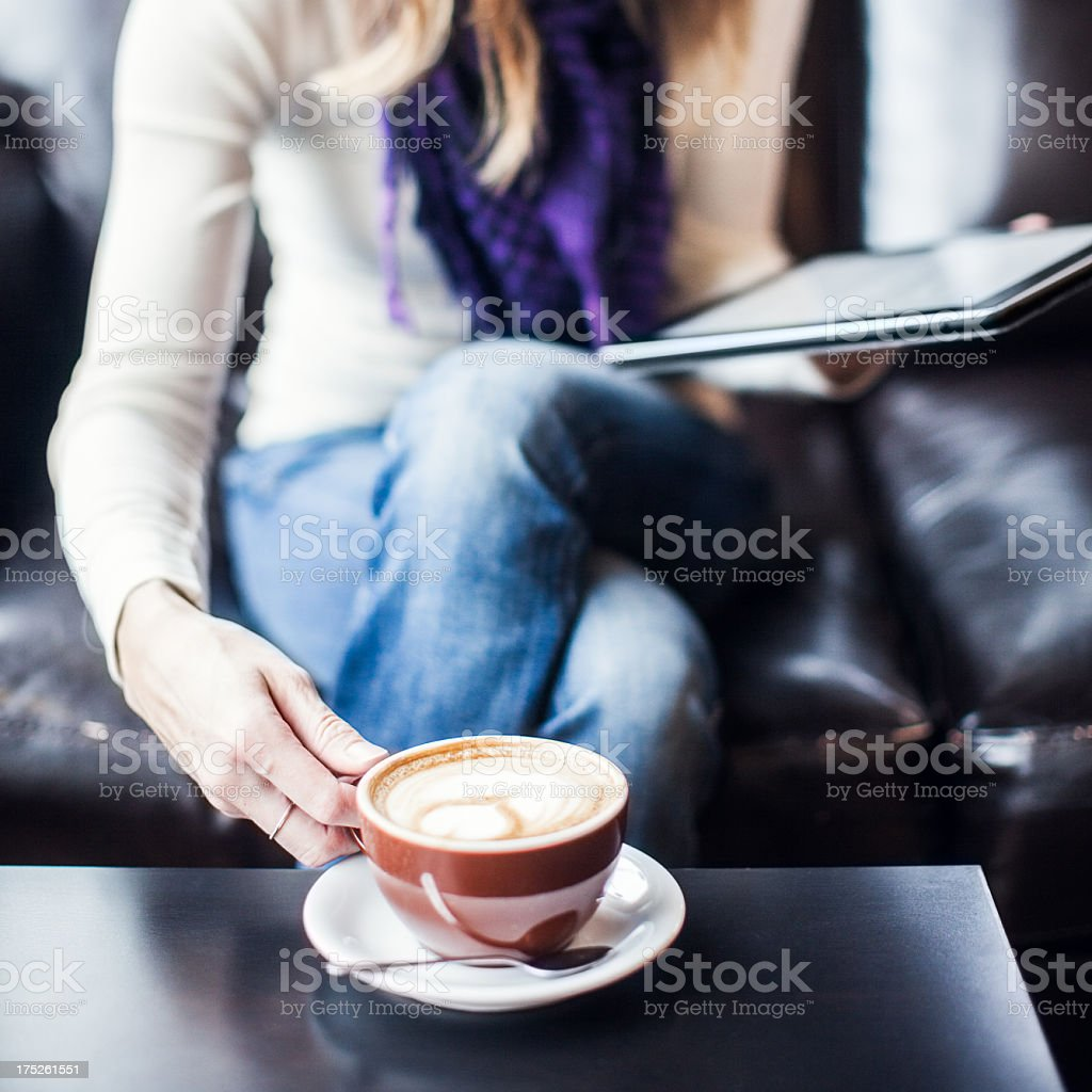 Content Woman with Digital Tablet and Coffee royalty-free stock photo