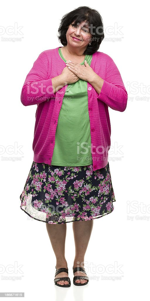 Content Woman With Hands on Chest stock photo