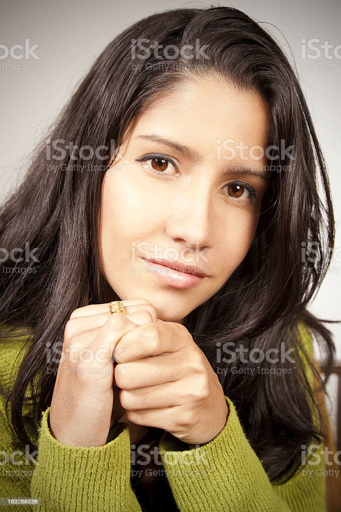Content Young Woman Holding Hands And Looking Forward royalty-free stock photo