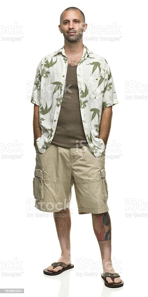 Contented Man in Hawaiian Shirt and Shorts stock photo