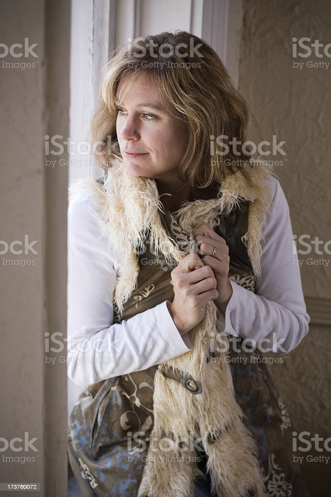 Contented Woman at Window royalty-free stock photo