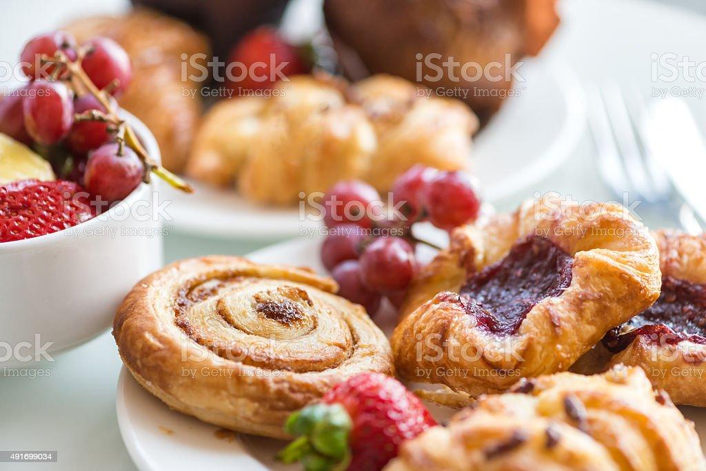 Continental Breakfast - Cinnamon Bun, Danishes, Rolls, Muffins, Fresh Fruit stock photo