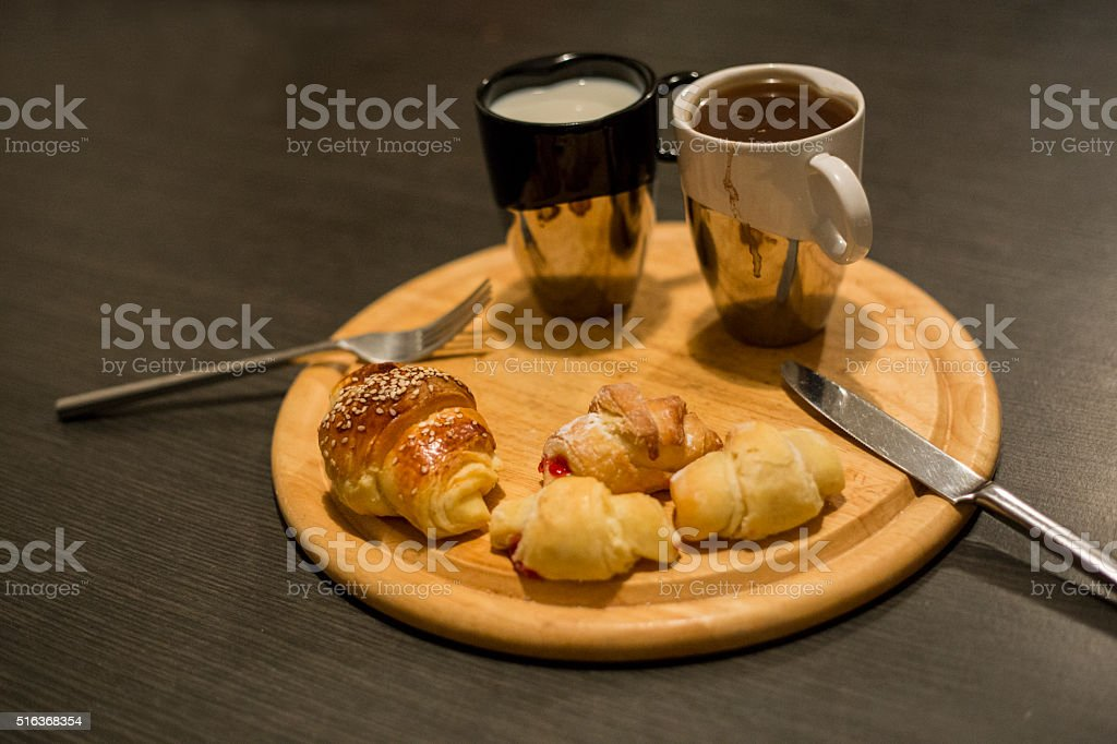 Continental breakfast coffee, milk and croissant stock photo