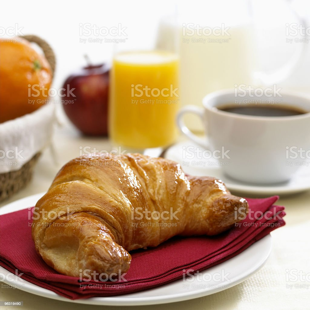 Continental breakfast coffee milk orange juice and croissant stock photo