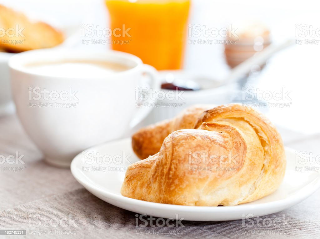 Continental breakfast of coffee and a croissant stock photo