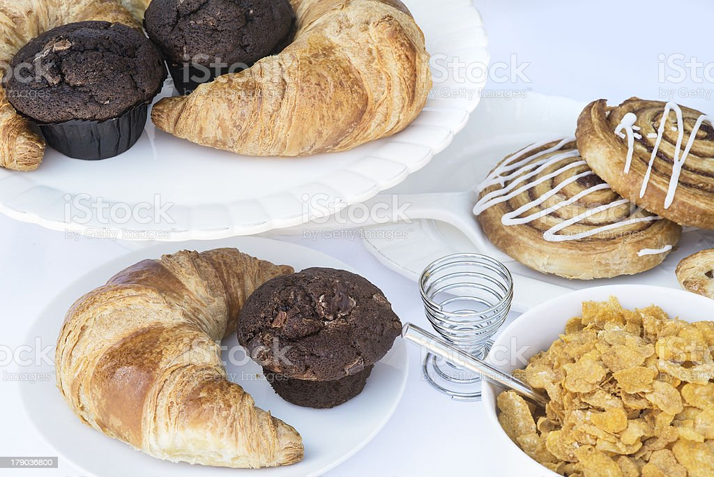 Continental breakfast table setting with pastries and cakes royalty-free stock photo