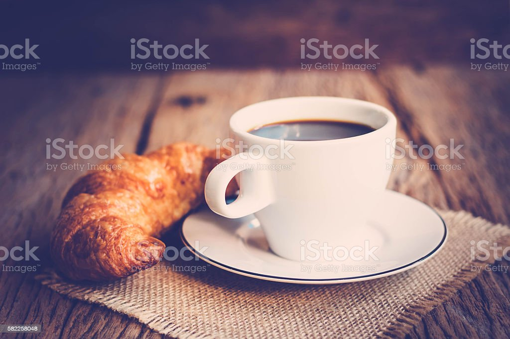 Continental breakfast with coffee and croissant stock photo