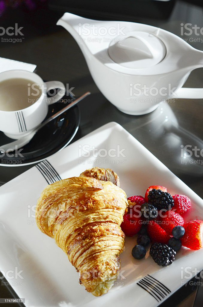 Continental Breakfast with Croissant coffe and summer fruits royalty-free stock photo