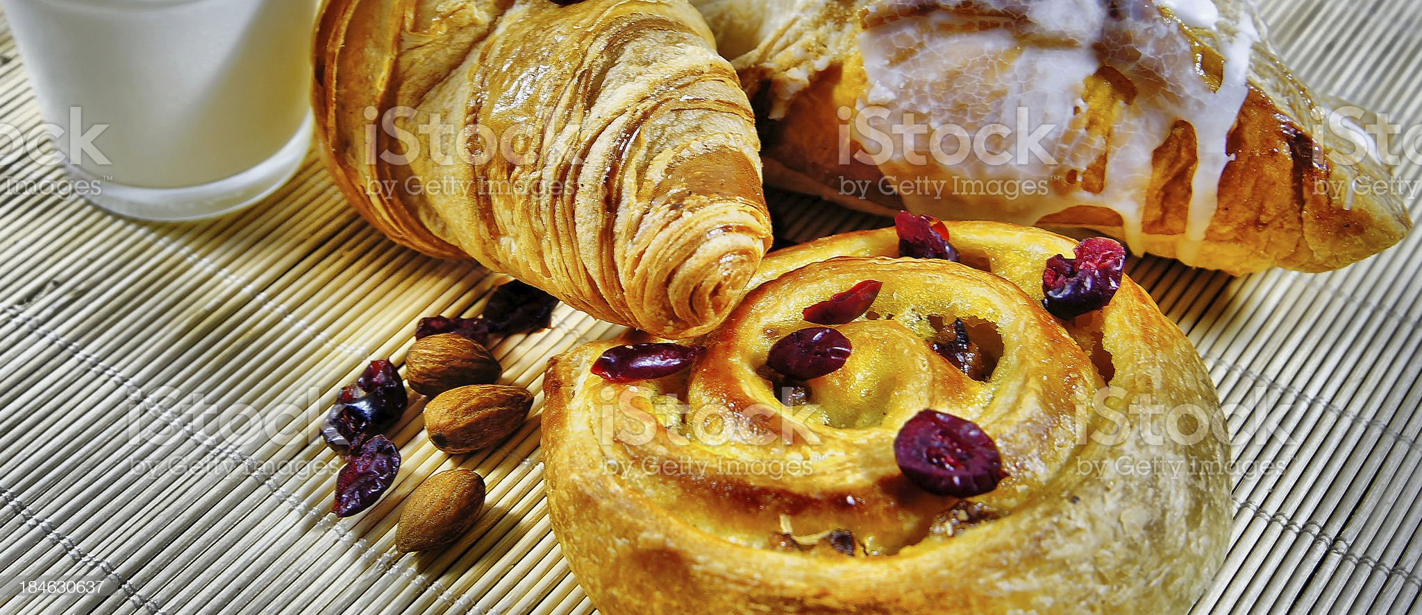 Continental, Croissant, Danish and glass of Milk royalty-free stock photo