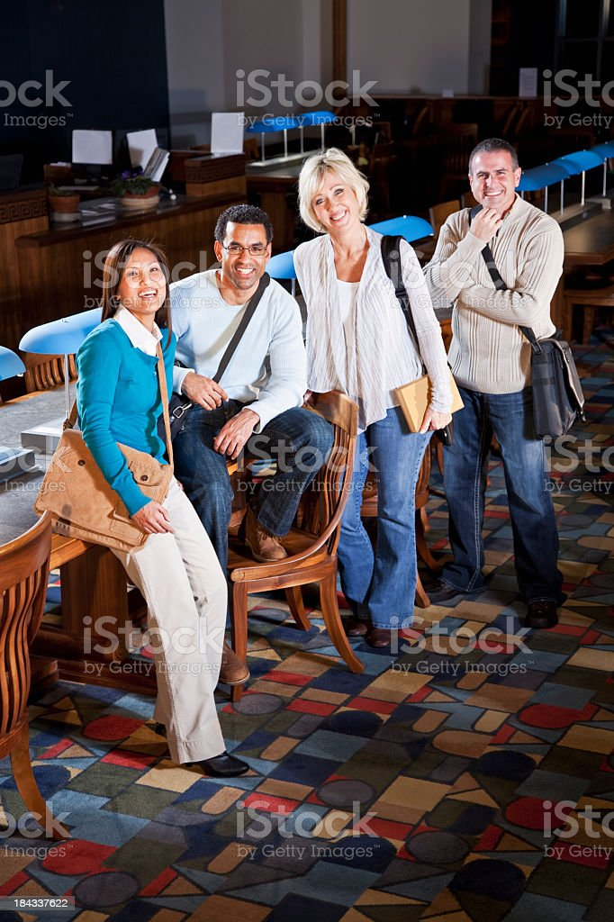 Continuing education, adult students in library stock photo