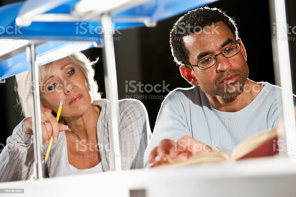 Continuing education, adult students studying stock photo