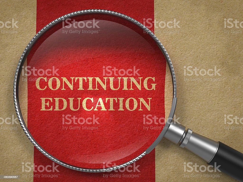 Continuing Education - Magnifying Glass. stock photo