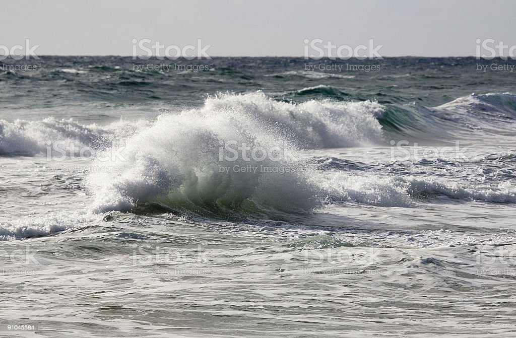 Contorted wave exploding in stormy surf 1 royalty-free stock photo