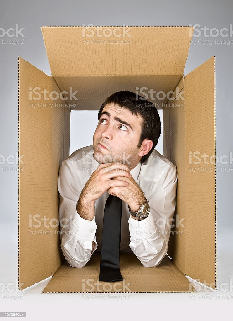 contortion business manager in box ready to travel stock photo