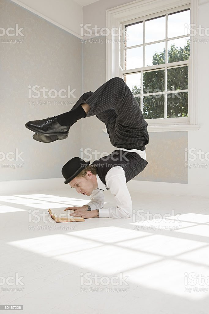 Contortionist reading a book stock photo