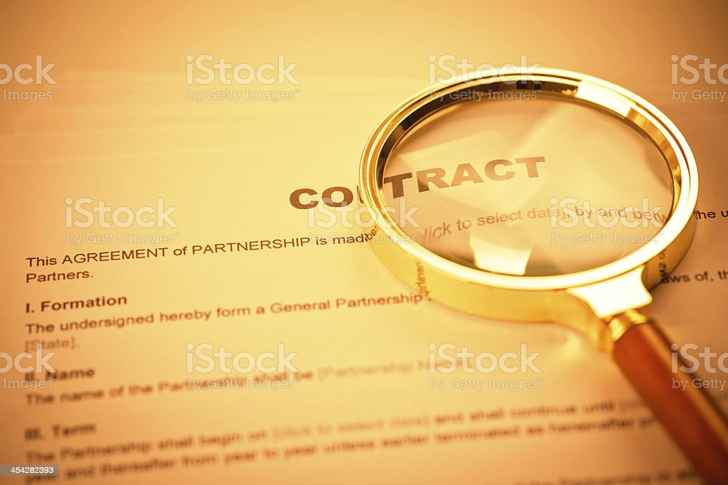 Contract and Magnifying Glass stock photo