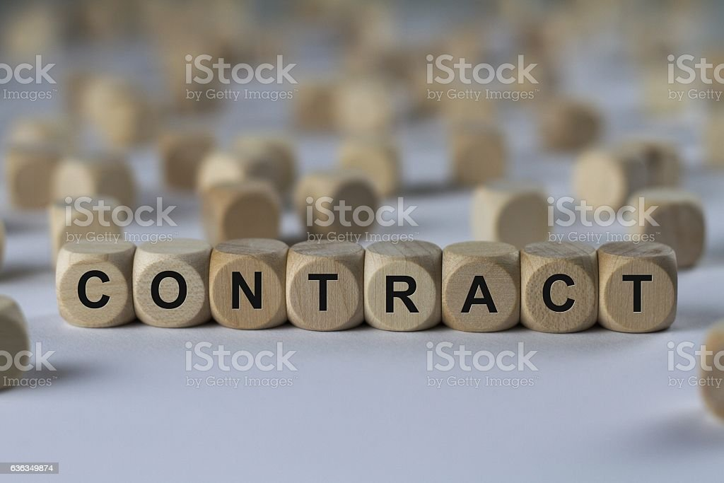 contract - cube with letters, sign with wooden cubes stock photo