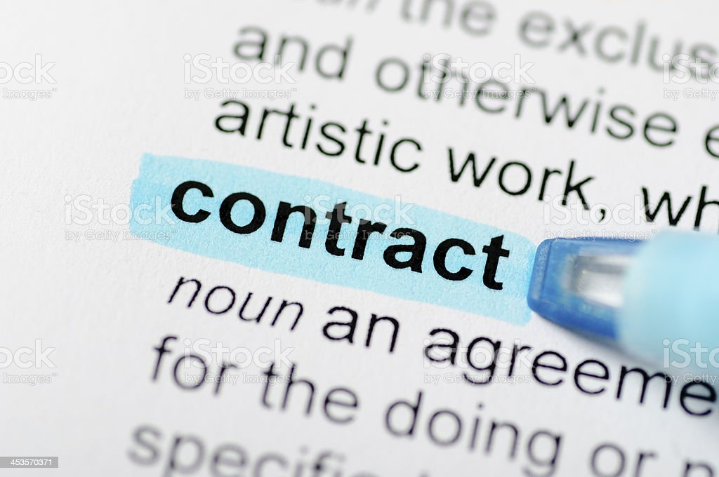 Contract highlighted in dictionary royalty-free stock photo