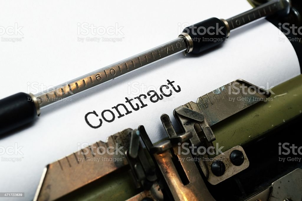 Contract on typewriter royalty-free stock photo