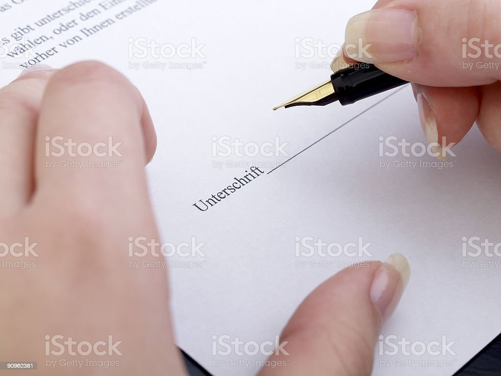 Contract papers being signed in German with fountain pen royalty-free stock photo