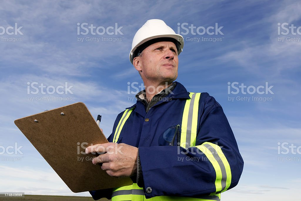 Contractor and Clipboard royalty-free stock photo