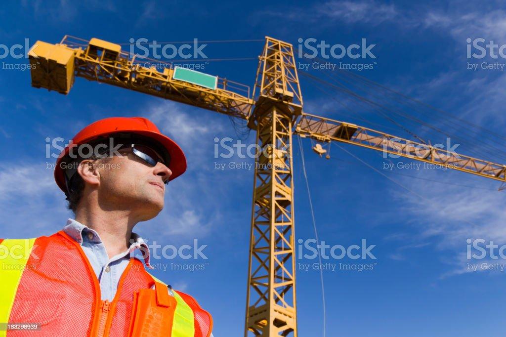 Contractor and Crane stock photo