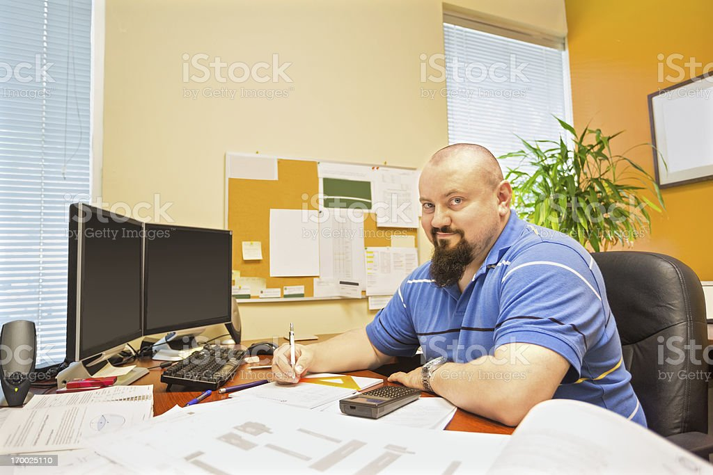 Contractor at his desk royalty-free stock photo