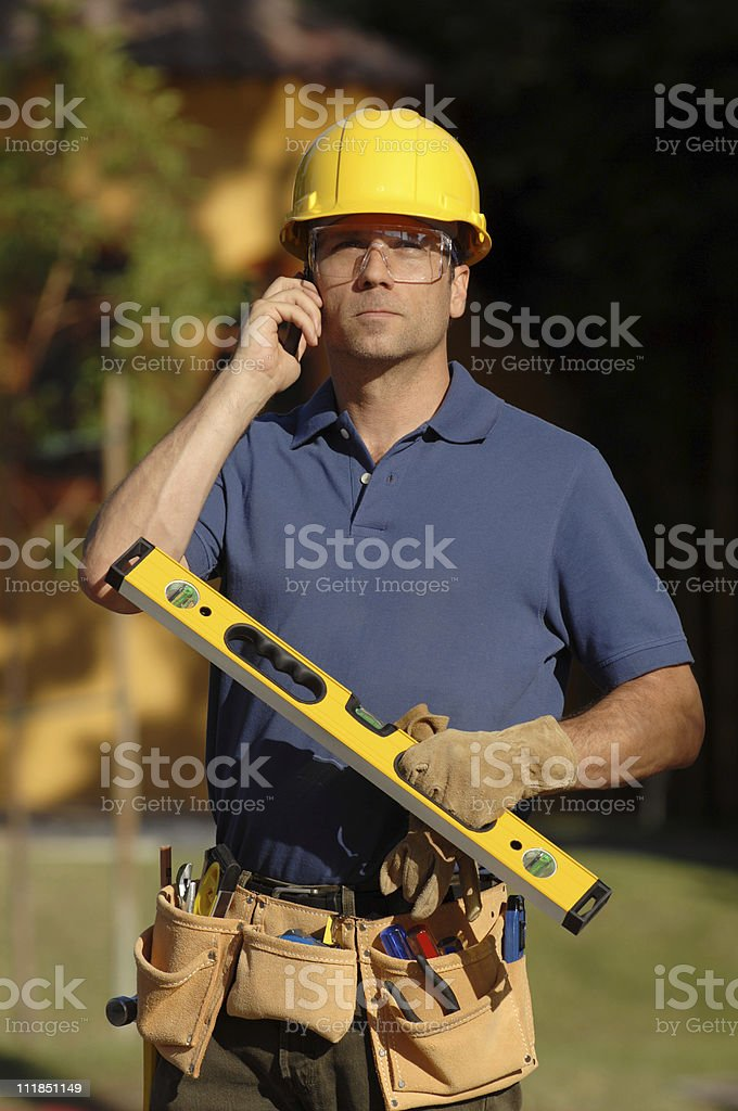 Contractor Carpenter Man on Mobile Phone royalty-free stock photo