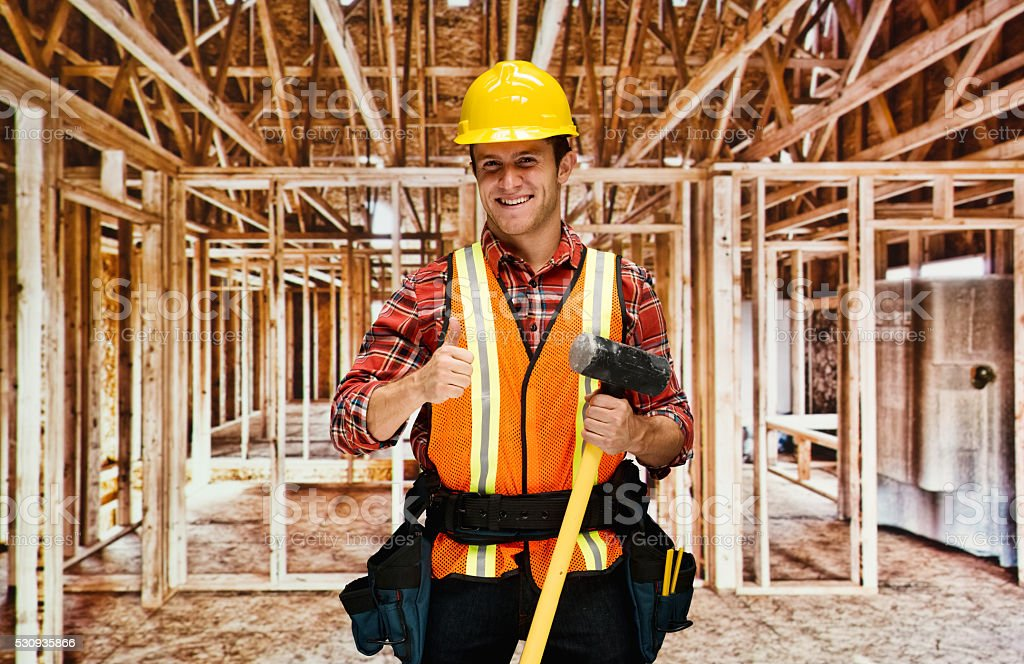 Contractor giving thumbs up stock photo