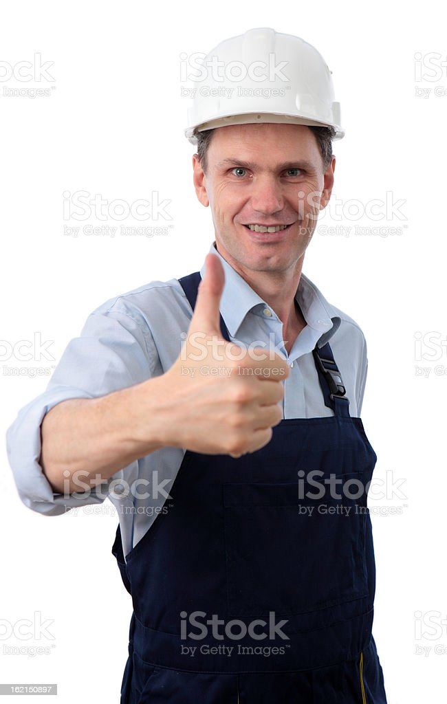 Contractor giving thumbs up sign against white background royalty-free stock photo