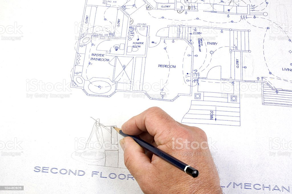 contractor making changes to Building plans royalty-free stock photo
