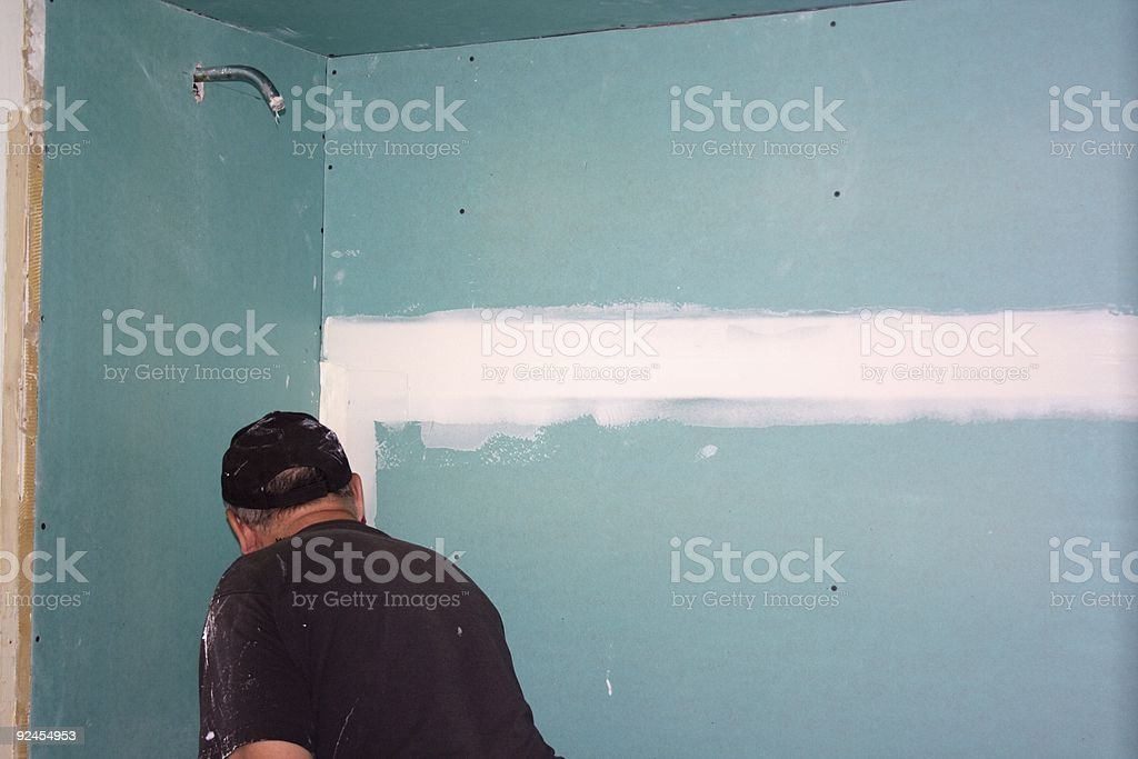 Contractor Mudding Drywall Seam royalty-free stock photo