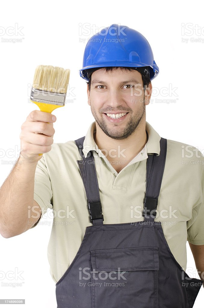 Contractor painting with a large brush royalty-free stock photo