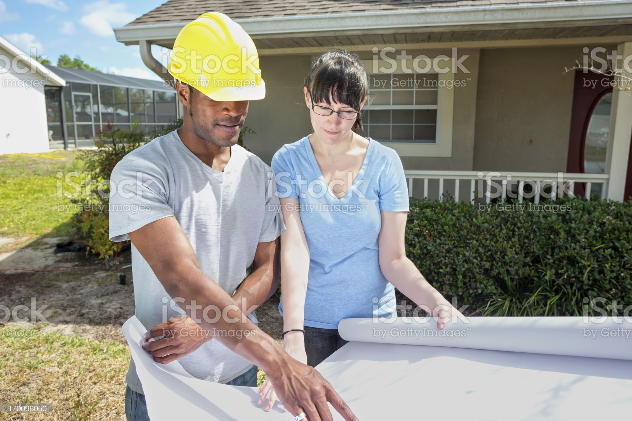 contractor talking to homeowner royalty-free stock photo