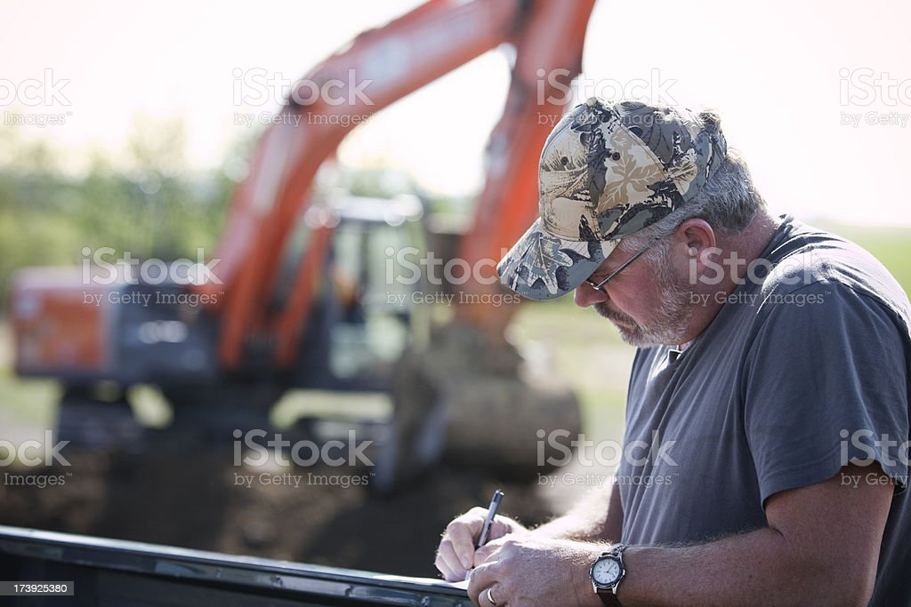 Contractor with excavator royalty-free stock photo
