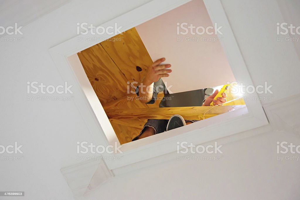 Contractor working in attic stock photo