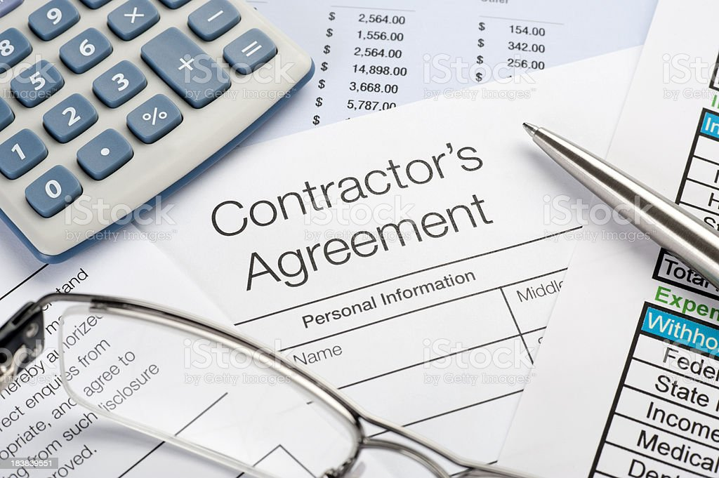 Contractors Agreement Form with pen, calculator royalty-free stock photo