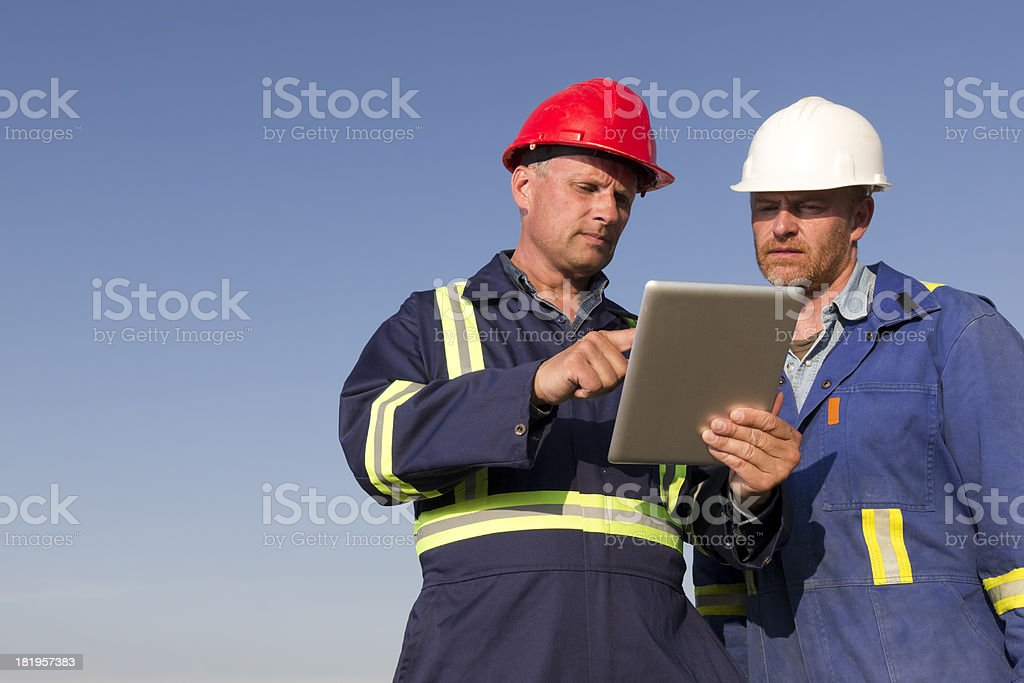 Contractors and Computer royalty-free stock photo