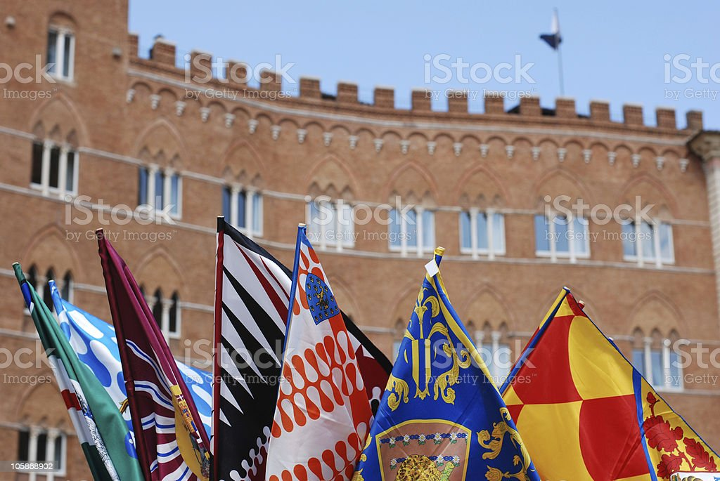 Contrada flags for sale on Il Campo in Siena, Italy stock photo