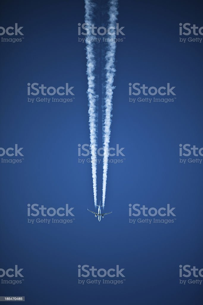 contrail above royalty-free stock photo