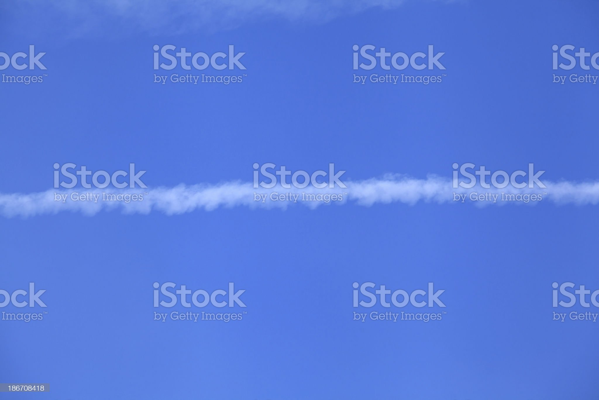 Contrail in Blue Sky royalty-free stock photo