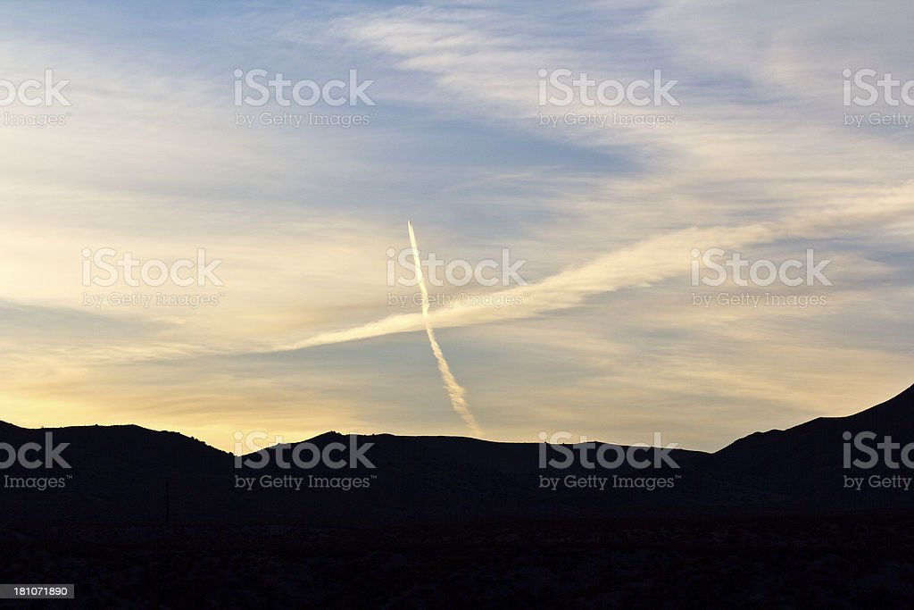 Contrails at sunset royalty-free stock photo